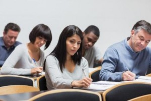 Students taking notes in lecture